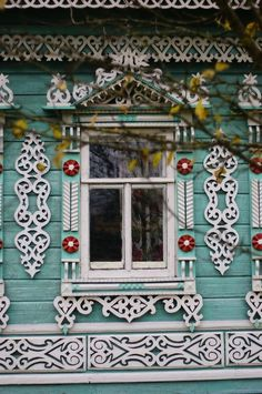 Russian wooden house in the town of Uglich. Window with openwork carved…