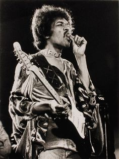 Jimi Hendrix toking.  ..u don't think he thought up all this magnificently outrageous guitar music straight, do u ?!?  ..please!  --RC