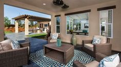 Contemporary Porch with Hasler Club Chair, High ceiling, Ceiling fan, slate tile…