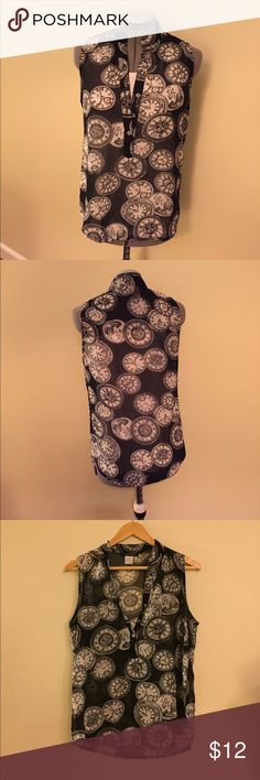 Solution brand clock sleeveless blouse. Size M Solution sleeveless sheer black blouse with unique white clock print. Great for work and lightweight is perfect for summer. Great condition. Size medium. Tops Blouses