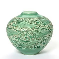 Nils Thorsson: Faiance vase modelled with fish motif in relief. Decorated with green transparent glaze. Signed monogram, Royal Copenhagen. H. 24,5 cm. Nils Thorsson, b. Eslöv, Skåne County 1898, d. 1975