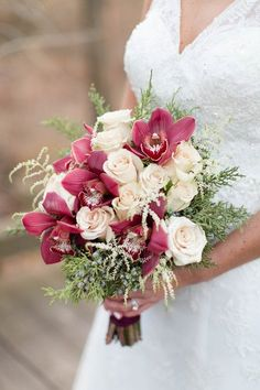 Winter wedding bouquet idea - burgundy + cream #weddingbouquet with orchids, roses and greenery {Candice Adelle Photography}