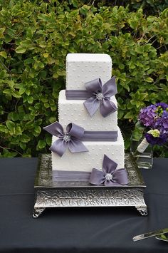 white and purple wedding cake, love the elegance in the simplicity