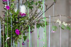 Simon Lycett's design using the British garden pinks in a cascading candelabra for British Flowers Week 2014 at New Covent Garden Flower Mar...