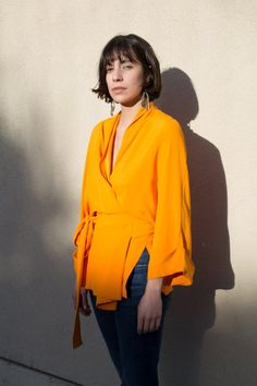 tennesee twill top in marigold by rodebjer + kimono style + with wide sleeves and side slits + features a shawl collar for multiple styling options + viscose Marigold, Kimono Fashion, Minimalist Fashion, Color Pop, Bell Sleeve Top, Ruffle Blouse, Stylish, Kimono Style, Sleeves