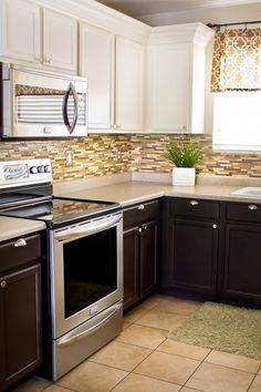 Dark Cabinets Below And Light Cabinets Above Diy Kitchen Updates On A Dime Dark Lower Cabinets White Upper Cabinets Stainless Appliances And Hardware