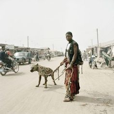 View Mallam Mantari Lamal with Mainasara, Nigeria from The Hyena and Other Men by Pieter Hugo sold at Photographs on London 21 May 2015 Learn more about the piece and artist, and its final selling price Pitbull, Hyena Man, World Press Photo, Out Of Africa, Baboon, Expositions, Documentary Photography, People Of The World, Les Oeuvres