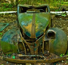 Blending in expertly with its surroundings, this classic motor lies inexplicably alongside a trail in a provinical park. Its moss covered remains are well and truly dug into the dirt, offering up an idea of how long it has been here.
