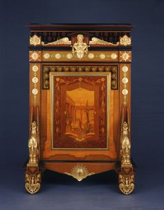 Jewelry Cabinet  Charles-Guillaume Diehl, French, 1811 - c. 1885. Probably designed by E. Brandely, French, active 1850 - 1870.  Geography: Made in France, Europe Date: 1867 Medium: Dyed and inlaid woods including maple, sycamore, satinwood, and ebony; gilded bronze decoration