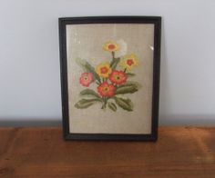 Vintage Floral Embroidered Picture  Orange and by jessamyjay. The orange and yellow blooms in this picture are created out of skilled needlework. Adds a cozy feeling to the walls of your home.