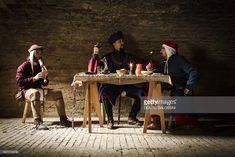 Interior of a tavern with musician and diners, 15th century. Historical reenactment.