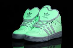Glow In the dark Adidas high tops. OMG I WANT THESE.