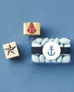 Nautical Wedding Ideas - Stamped Details: Grab a stamp with a seaside motif and an ink pad to decorate favor tags and more. Here, an anchor-adorned circle attached to ribbon dresses up dragées.