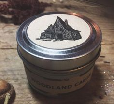 Woodland cabin - Travel tin. Travel deep into the forest where you will find the most magickal treehouse filled with the most mesmerizing aromas of pine, apples & fir with hints of balsam, ginger, sage and fallen leaves. But be careful not to disrupt anything for the witch who owns this home lurks near by. *This magickal candle comes with a wood wick, topped with rose, sage, mugwort, and lavender!