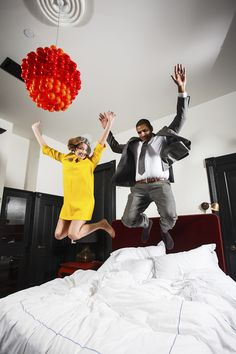 Bride and groom jumping on the bed! Love this! Photo by Jake Holt Photography | via junebugweddings.com