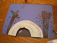 Cute bear hibernation craft using a paper plate...thinking a large brown pom pom for the bear in the cave!