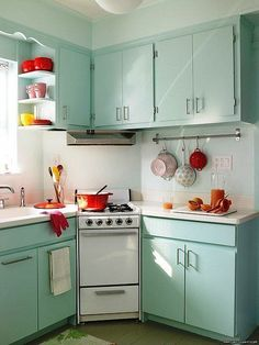 The shelves on cabinet by sink and the potholder thing.