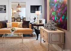 Accessories, Wonderful Design Of The Interior Design With White Wall And Big Painting On The Wall And Light Brown Sofa And Some Cushions: Much Information From Modern Homes Magazine