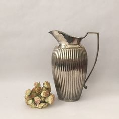 elegant vintage silver plated pitcher in a classic reeded