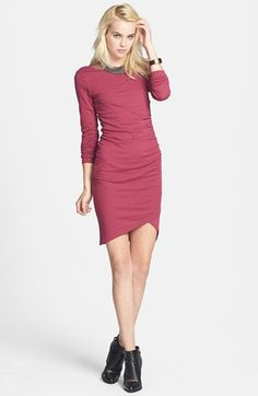 Flattering ruching highlights your curves in a soft knit dress finished with a trend-right wrap detail at the hem.