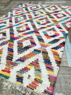 Three sizes available! The fair trade Baku coarse cotton kilim rug is hand loomed on a fair trade basis and features an attractive geometric design. Please note that this is coarse cotton which is not as soft as other versions but very hard wearing!