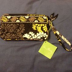 Vera Bradley wristlet in baroque This is a brand new with tags Vera Bradley wristlet in baroque. It has a zippered pocket and credit card slots inside. Vera Bradley Bags Clutches & Wristlets