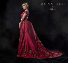 Royal Flair With Wine Red Gown Adorned In Sequins.