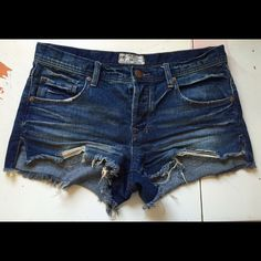 Free people denim shorts 26 Excellent used condition Free people shorts 26. Medium dark washed denim and slits up the side. Button fly closure. Run large. I'm a 25 in most jeans and a 26 in free people, but these would best fit a 26 or a 27 Free People Shorts Jean Shorts