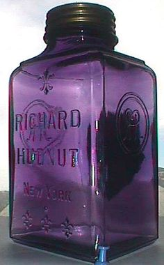 Large antique Purple Glass jar with embossed fleur de lis