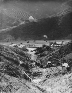 (1931)* - Looking down into the site of the future Pilgrimage Play Amphitheater, revealing the Cahuenga Pass and the Hollywood Bowl in the background. The new structure will resemble the architecture of the Holy Land for the purposes of the play performed there.