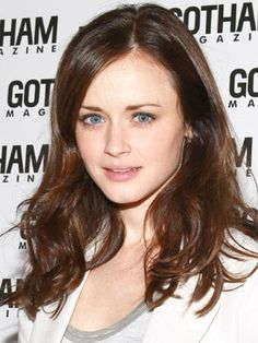 A diagonal part adds a modern flair to Alexis Bledel's soft and wavy hairstyle.