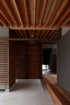 Exposed timber beams, studio? House In Gankaiji / Nakasai Architects