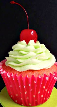 Cherry Limeade Cupcakes ~ cherry cake full of maraschino cherry chunks, topped with tangy lime frosting... DELISH!