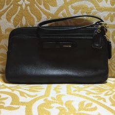 Coach Wristlet Black Black Coach Wristlet. Like new, barely used. Lots of pockets and very easy to use. Adorable! Coach Bags Clutches & Wristlets