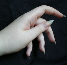 I used to do this, but my nails sadly never got that long...