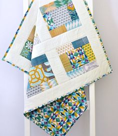 If an ageless quilt with hand pieced patchwork fabrics with beautiful gemstone florals in teal, green, gold, blue and purple is your plan for your baby's nursery décor you will love this! Quilted Baby Blanket, Baby Patchwork Quilt, Baby Girl Quilts, Girls Quilts, Handmade Baby Quilts, Handmade Pillows, Purple Quilts, Quilting Designs, Quilting Tips