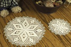 Star Doily and Coaster Set crochet pattern available at TheCrochetArchitect.com.