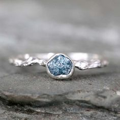 Looking for some color - a raw blue diamond, twig engagement ring from ASecondTime via etsy. #rawuncutdiamonds #bkue