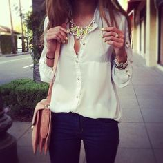 Flowing white blouse and a statement necklace