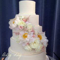 This is Dilly Lily's latest cake creation decorated with peonies, garden roses and spray roses.