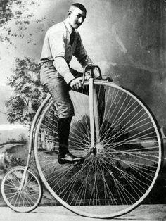 "Man on an old bicycle - Penny Farthing aka ""boneshaker"""