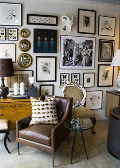 This wall collage is done right with a mix of items: mirrors, sculpture, pictures...