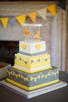 Fun yellow and grey cake: Merrit's Bakery.