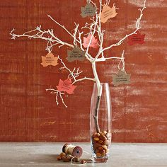 Have your family members write what they are thankful for on a paper leaf and add it to natural tree branches for a Thanksgiving centerpiece you'll all be grateful for. Plus get 30 more fall table decorating ideas!