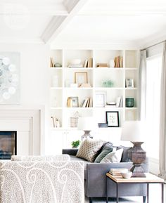 Problem: The living room in our new home has big, embedded bookshelves but I'm not a big reader - 11 living room design dilemmas and solutions