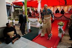 NUKU'ALOFA, TONGA - MAY 3: Tongan King George V and his dog Pip exit the wedding reception of his niece the Honorable Titilupe Fanetupouvava'u Tuita to Second Lieutenant Siaosi Kiu Tau Ki Vailahi Kaho on May 3, 2007 in Nuku'alofa, Tonga. Tonga is one of the last surviving monarchies in the Pacific islands, however there has been a recent push towards democratic reform, challenging the people of Tonga to maintain their cultural heritage while conforming to modern day capitalism. (Photo by Amy…