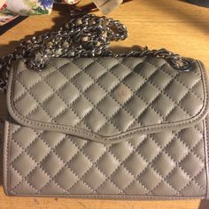 FREE GIFT Rebecca Minkoff Mini Quilted Gray Rebecca Minkoff mini quilted affair crossbody bag in gray. Flaw - stain on front - have not tried to remove. Bag is in very good condition otherwise. The leather running through the chains is a bit worn. Feel free to make an offer comes with free gift! Rebecca Minkoff Bags Crossbody Bags
