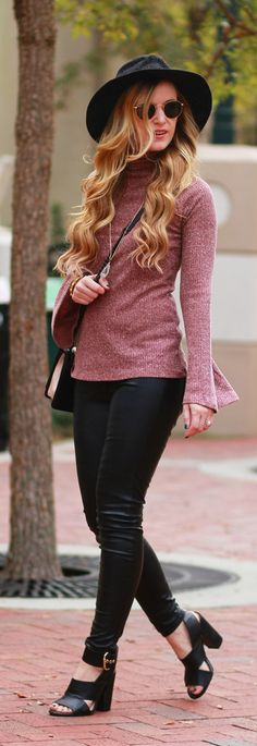Casual fall outfit styled with a bell sleeve sweater, faux leather pants, and black saddle bag