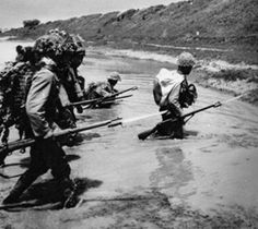 Imperial Japanese Army infantrymen tread water in China, 1942.