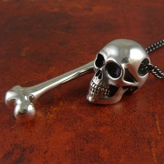 Human Skull & Femur Bone Necklace in Antique Silver by Lost Apostle, $95.00  Need!! So perfect. ❤️ Wish I could buy me a bday present.